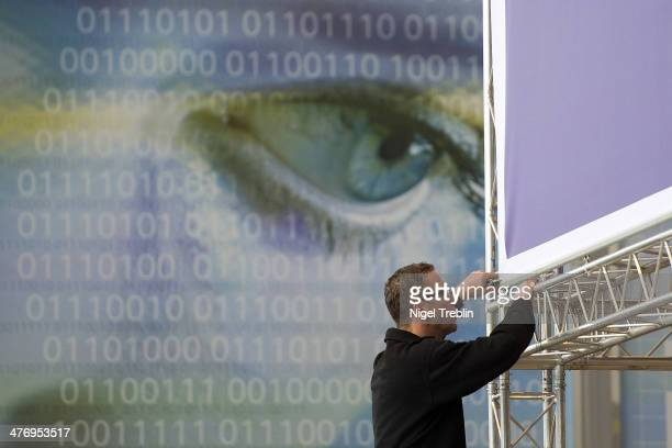 Worker prepares an exhibitor stand in preparation of CeBIT 2014 technology trade fair on March 6, 2014 in Hanover, Germany. CeBIT 2014, the world's...
