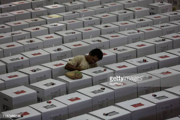 A worker prepares election materials before their distribution to polling stations in a warehouse in Jakarta Indonesia on 16 April 2019 Some 192...