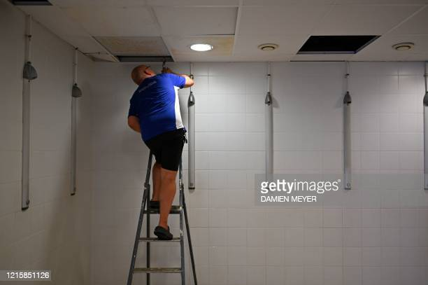 A worker prepares fixes a shower at La conterie public swimming pool in ChartresdeBretagne suburbs of Rennes western France on May 28 2020 Swimming...