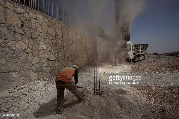 A worker prepares foundation for a new construction on September 27 2010 in the West Bank settlement of Shaar Binyamin as Israel ended its 10month...