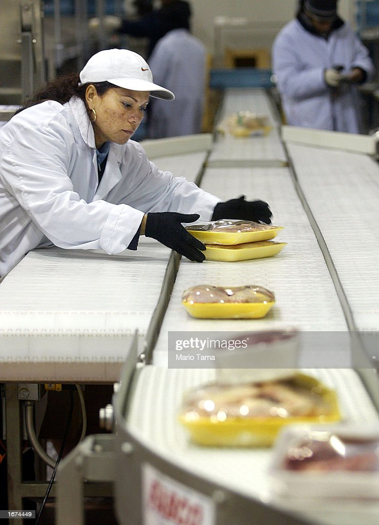 A worker prepares meats for delivery in the new FreshDirect online grocery service warehouse December 5, 2002 in New York City. The state-of-the-art 300,000 square foot facility houses 200 workers with a fleet of 23 trucks making deliveries based on 2-hour appointment slots to New Yorkers. FreshDirect charges a flat $3.95 delivery fee. In an era of failed Web businesses, FreshDirect owner Joe Fedele says he hopes to turn a profit in six months.