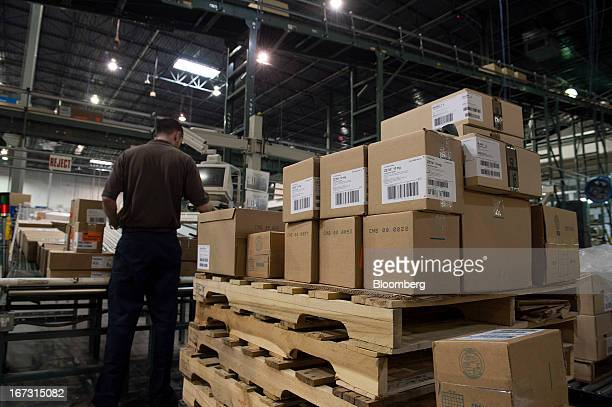 A worker prepares orders to be loaded for shipment at a United Parcel Service Inc Healthcare Supply Chain and Distribution Center in Atlanta Georgia...