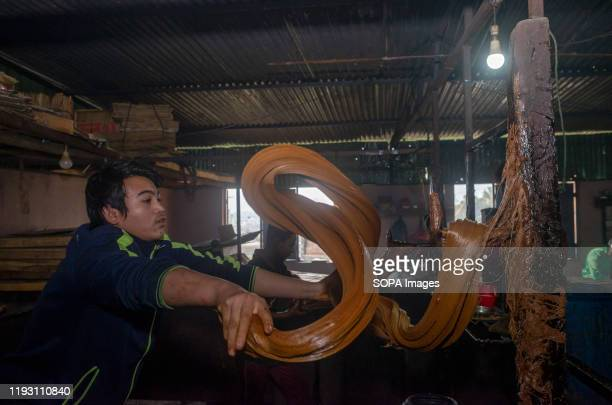 A worker prepares raw hard molasses to make chaku for the Maghe Sankranti festival Chaku Molasses is usually prepared and consumed during the Maghe...