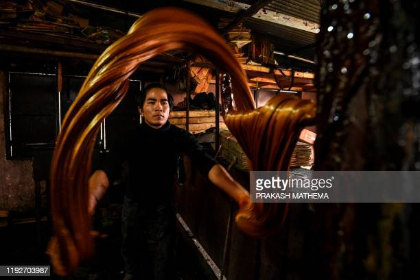 TOPSHOT A worker prepares raw hardened molasses locally know as Chaku for the upcoming Maghe Sankranti festival in Tokha on the outskirts of...