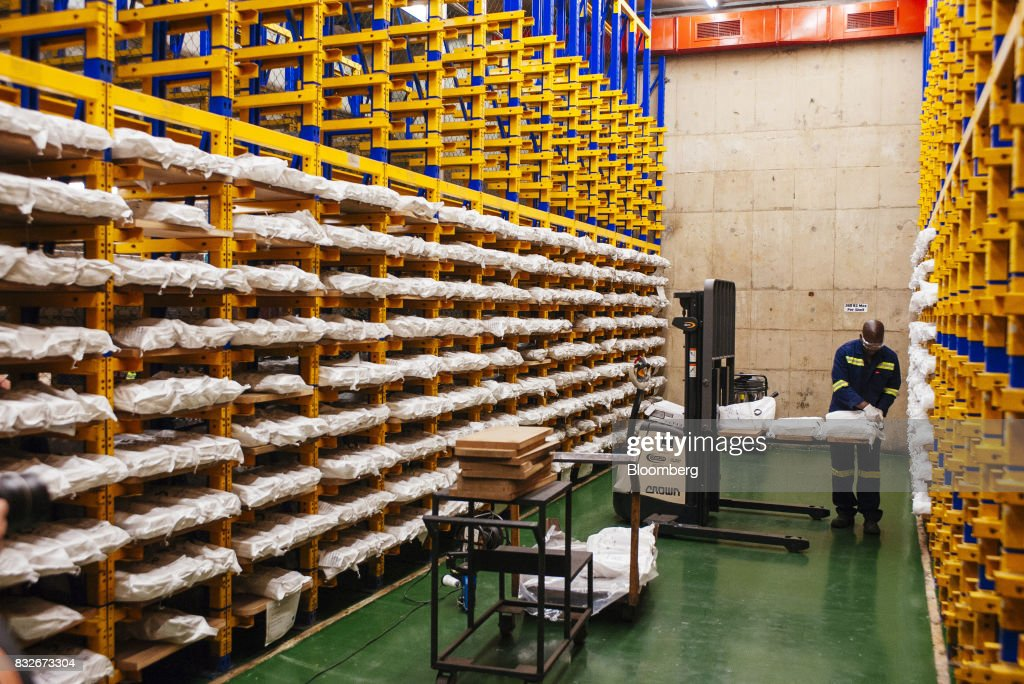A worker prepares sacks of gold in a storage bay awaiting ahead of delivery to the vault at the Rand Refinery Ltd. plant in Germiston, South Africa, on Wednesday, Aug. 16. 2017. Established by the Chamber of Mines of South Africa in 1920, Rand Refinery is the largest integrated single-site precious metals refining and smelting complex in the world, according to their website. Photographer: Waldo Swiegers/Bloomberg via Getty Images