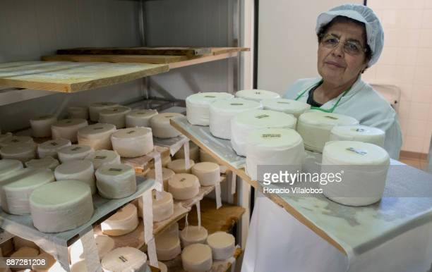 A worker prepares sheep cheese for aging at five stars hotel Parador Casa da Insua during Gastronomic FAM Tour on November 29 2017 in Penalva do...