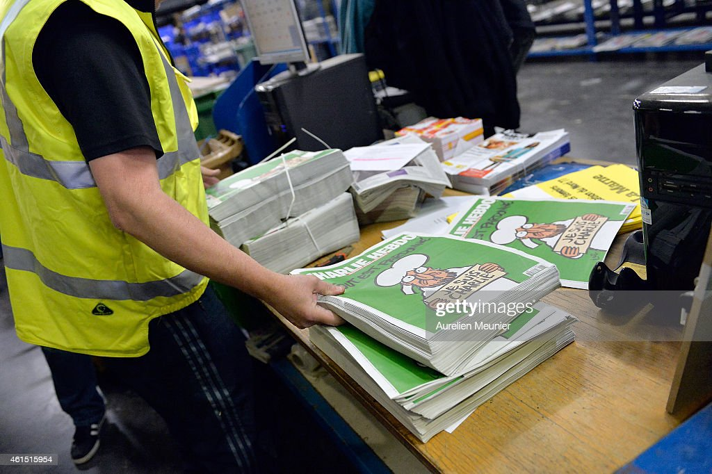 A worker prepares the new edition of Charlie Hebdo for delivery in a press distribution center in the suburbs on January 14, 2014 in Marne-la-Vallee, France. Three million copies of the controversial magazine have been printed in the wake of last week's terrorist attacks. A second delivery of the magazine is scheduled for tomorrow.