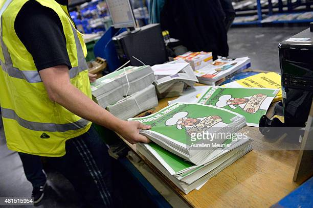 Worker prepares the new edition of Charlie Hebdo for delivery in a press distribution center in the suburbs on January 14, 2014 in Marne-la-Vallee,...