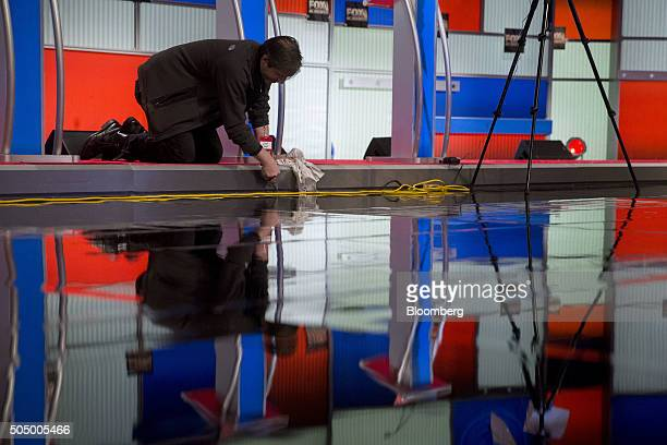 A worker prepares the stage ahead of the Republican presidential candidate debate at the North Charleston Coliseum and Performing Arts Center in...