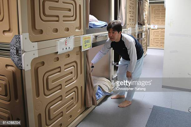 A worker prepares to rest inside the capsule hotel as workers continue the decontamination and decommissioning process at the Tokyo Electric Power...