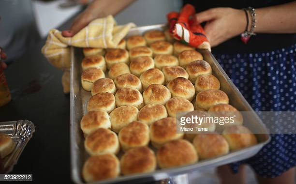 Worker prepares to serve USstyle biscuits at the annual Festa Confederada or Confederate Party on April 24 2016 in Santa Barbara d'Oeste Brazil The...