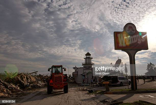 A worker prepares to start removing debris from Seawall Boulevard left behind by Hurricane Ike September 16 2008 in Galveston Texas Most of the...