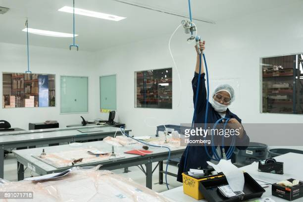 A worker prepares to vacuum pack aircraft parts at the Tighitco Inc manufacturing facility in San Luis Potosi Mexico on Thursday Nov 16 2017 With 312...