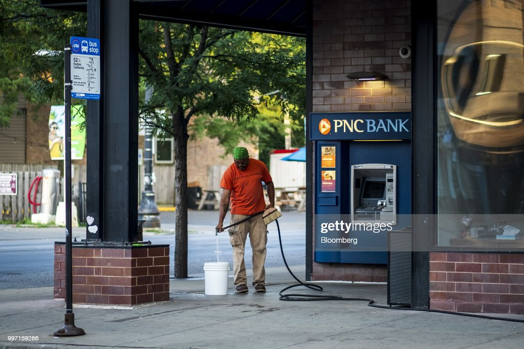 A worker prepares to wash the outside of a PNC Financial Services Group Inc. bank branch in Chicago, Illinois, U.S., on Thursday, July 12, 2018. PNC Financial Services Group Inc. is scheduled to release earnings figures on July 13. Photographer: Christopher Dilts/Bloomberg via Getty Images