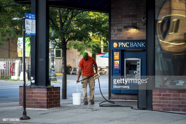 A worker prepares to wash the outside of a PNC Financial Services Group Inc bank branch in Chicago Illinois US on Thursday July 12 2018 PNC Financial...