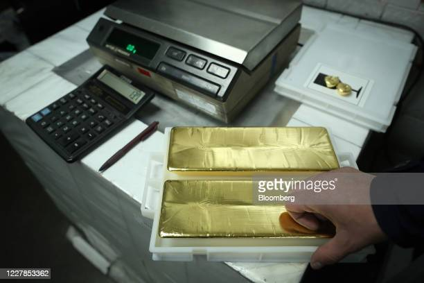 Worker prepares to weight 12.5 kilogram gold ingots at the Uralelectromed Copper Refinery, operated by Ural Mining and Metallurgical Co. , in...