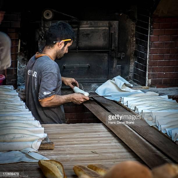 Worker preparing bread in an original bakery in Fener Istanbul