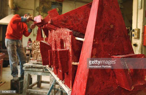 A worker preparing some wax casts in Battaglia artistic foundry in Milan This is the foundry where the works by Italian sculptor Arnaldo Pomodoro are...