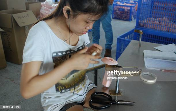 A worker produces an artificial vagina in a factory in the southern Chinese city of Dongguan China 27 July 2013 Because girls are aborted in favor of...