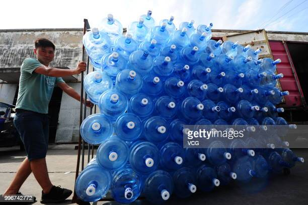 A worker produces barreled drinking water at a factory on July 10 2018 in Taicang Jiangsu Province of China The factory in Taicang produces more than...