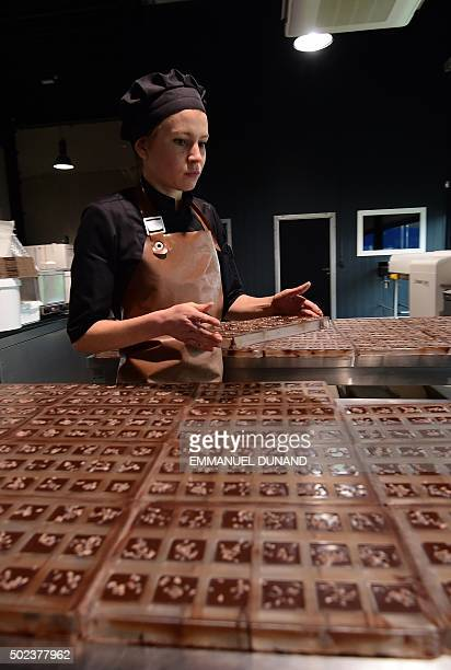A worker produces chocolate at the Benoit Nihant's chocolate factory in Awans on December 11 2015 In a country where chocolate is a national pastime...