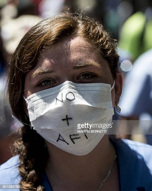 A worker protests against the Pension Fund Administrators Chile's privatized pension system in front of the La Moneda presidential palace in Santiago...
