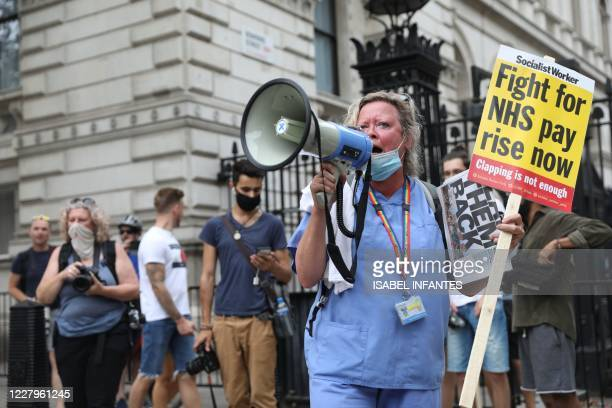 Worker protests outside Downing Street during a march through the streets of London on August 8 to demand a pay rise.
