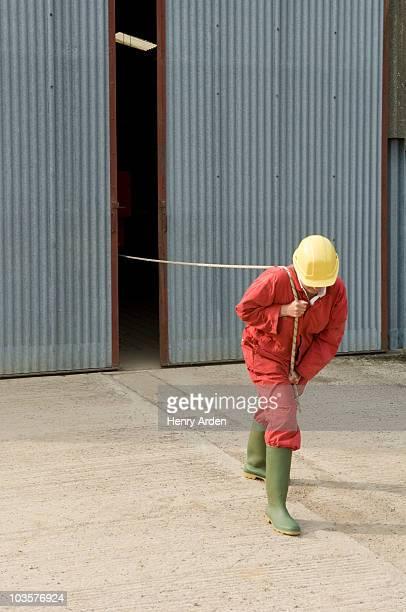 Worker pulling unseen object