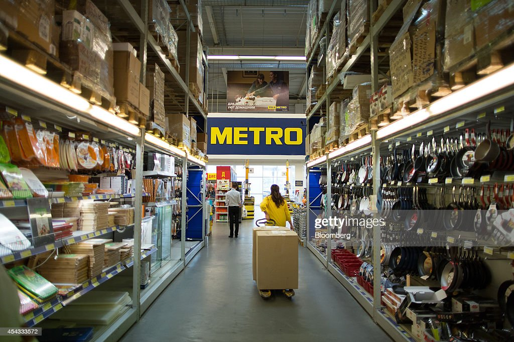 A worker pulls a pallet truck loaded with product boxes along an aisle of homewares inside a Metro Cash & Carry store, the Russia unit of Metro AG, in Moscow, Russia, on Friday, Aug. 29, 2014. Metro Cash & Carry has warned that domestic food suppliers are trying to increase some food prices as local produce is substituted for EU, Norwegian and U.S. equivalents which have been sanctioned. Photographer: Andrey Rudakov/Bloomberg via Getty Images