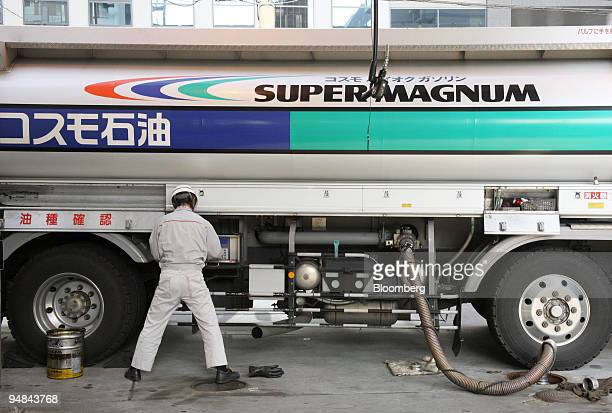 A worker pumps out gasoline into reserve tanks from a fuel tanker at a Cosmo Oil Co gas station in Tokyo Japan on Wednesday April 30 2008 Japan's...