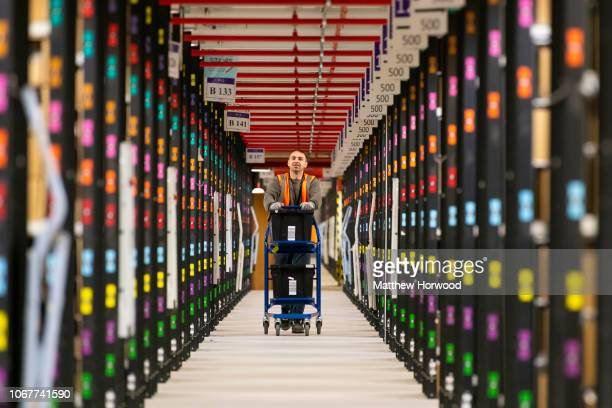 Worker pushes a trolley in the Amazon fulfillment centre as staff gear up for Black Friday and Christmas on November 13, 2018 in Swansea, Wales. The...