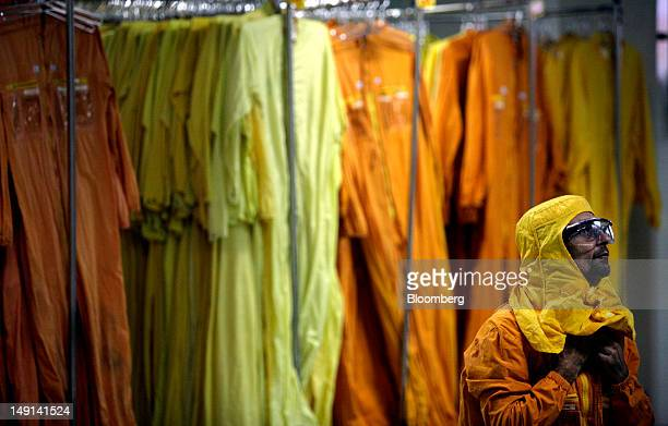 A worker puts on hazmat gear before entering the Angra II reactors at the Angra Nuclear Power Plant in Angra dos Reis Brazil on Friday July 13 2012...