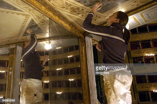 A worker puts the finishing touches to renovation work at La Scala opera house in Milan Italy Friday November 19 2004 La Scala reopens December 7...