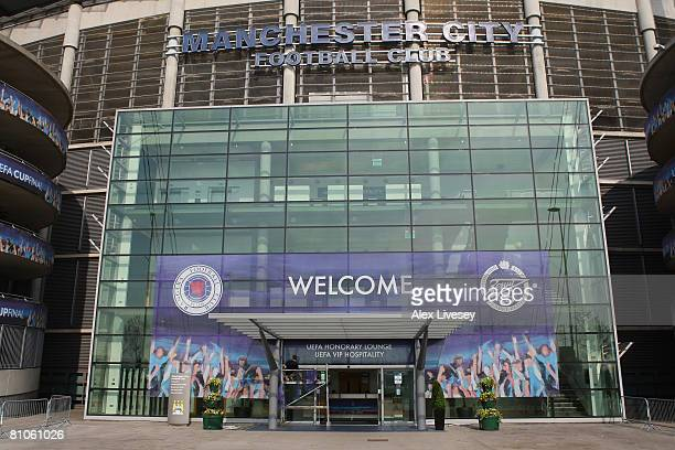 A worker puts up UEFA Cup Final boards around the City of Manchester Stadium ahead of the UEFA Cup Final to be played on Wednesday evening between...
