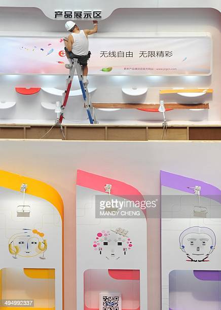 A worker putting the finishing touches to the booths at the Taipe World Trade Centre the venue of the annual Computex Asia's leading IT trade fair in...