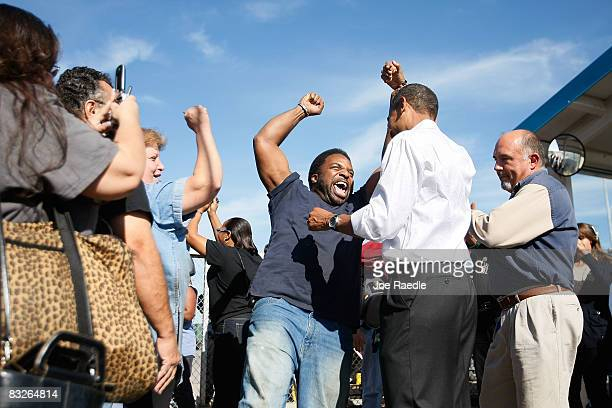 A worker raises the arm of Democratic presidential nominee US Sen Barack Obama as yells out that this is the next president of the United States...