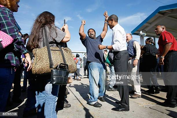 A worker raises the arm of Democratic presidential nominee US Sen Barack Obama as yells out that this is the next president of the United States as...