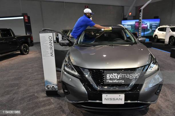 Worker readies a Nissan for exhibit at the 2020 New England Auto Show Press Preview at Boston Convention & Exhibition Center on January 16, 2020 in...