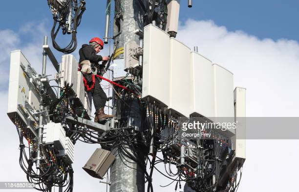 A worker rebuilds a cellular tower with 5G equipment for the Verizon network on November 26 2019 in Orem Utah The new 5G networks that are coming...
