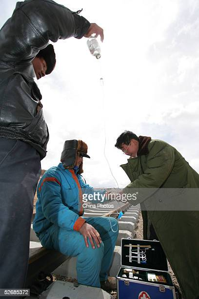 A worker receives treatment for his mountain sickness at the construction site of the 2040km long QinghaiTibet Railway at an altitude of 4900 meters...