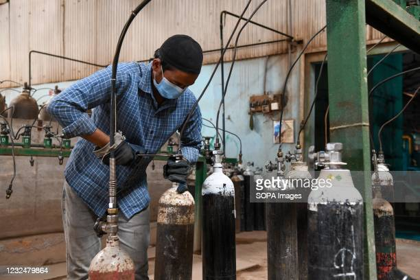Worker refilling oxygen cylinders at an oxygen plant. Supply of medical oxygen to public hospitals is under strain as the demand for the...