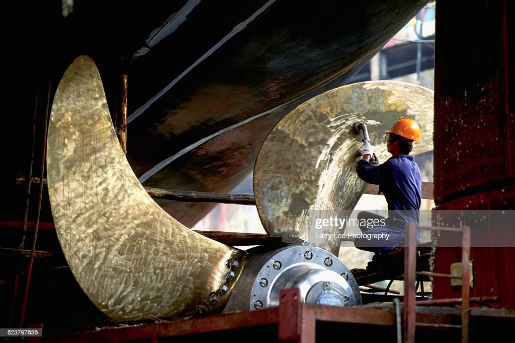 Worker Refurbishing Ship Propeller Stock Photo - Getty Images
