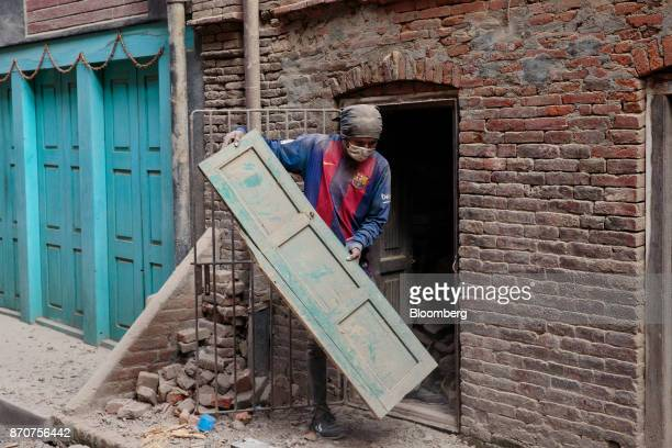 A worker removes a door during the reconstruction of a building in Lalitpur Kathmandu Valley Nepal on Wednesday Nov 1 2017 India and China have often...
