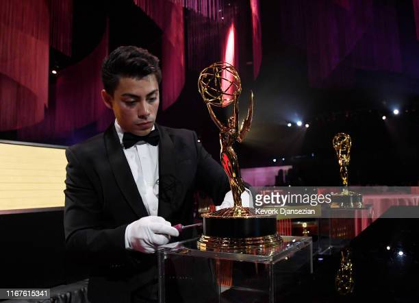 Worker removes a plaque from a Emmy Award statue in the engraving station during 71st Emmy Awards Governors Ball and 2019 Creative Arts Governors...