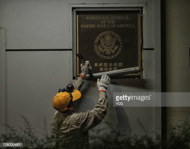 Worker removes a plaque of the US Consulate General in Chengdu on July 26, 2020 in Chengdu, Sichuan Province of China.