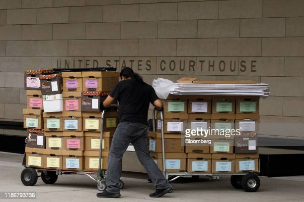 A worker removes boxes of legal documents from federal court in Los Angeles California US on Friday Dec 6 2019 Elon Muskbeat back a defamation claim...