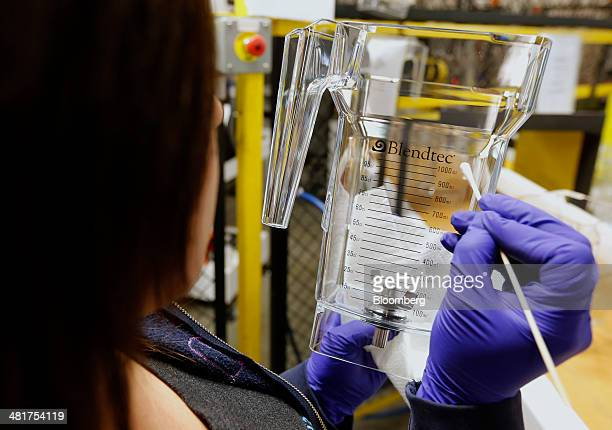 A worker removes flaws from an acrylic blender jar at the KTec Inc Blendtec factory in Orem Utah US on Wednesday March 26 2014 The Institute for...