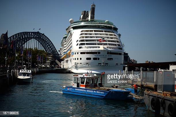 A worker removes garbage from the waters in Sydney Harbour on November 7 2013 Unemployment in Australia remained unchanged at 57 percent in October...