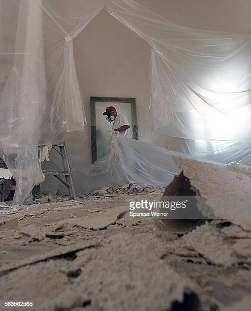Worker removes scraped Acoustic ceilings from inside a Thousand Oaks residence Acoustic ceilings also known as ''popcorn'' or ''cottage cheese''...