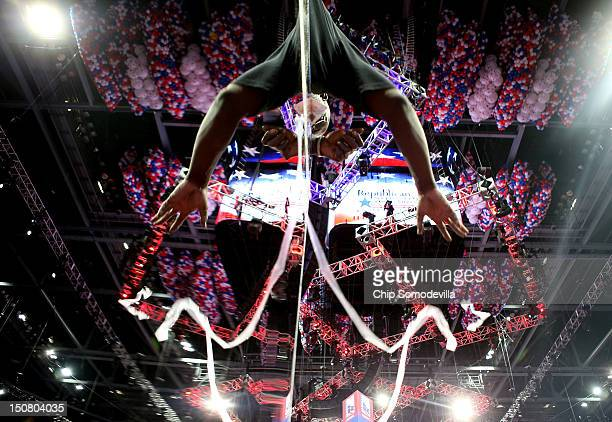 A worker removes the plastic from a mirror on the floor ahead of the Republican National Convention at the Tampa Bay Times Forum on August 26 2012 in...